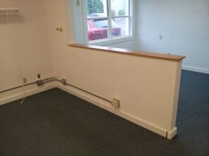 Before: a divided office space