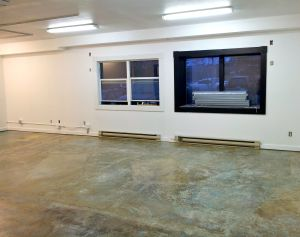 After: Concrete floor and white surfaces. Yay!